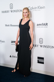 Uma Thurman donned a simple black gown by Calvin Klein for the amfAR Hong Kong Gala.