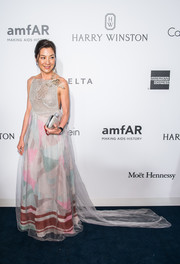 Michelle Yeoh looked regal in a Schiaparelli Haute Couture gown with an embellished bodice and a color-block print skirt at the amfAR Hong Kong Gala.