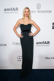 Karolina Kurkova went for minimalist elegance in a strapless black column dress by Calvin Klein at the amfAR Hong Kong Gala.