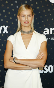 Karolina Kurkova accessorized with a silver bangle and a matching chain necklace for the amfAR Celebrity Poker Tournament.