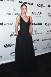 Rosie Huntington-Whiteley went for classic, simple elegance at the amfAR Inspiration Gala in a black Saint Laurent gown with a fitted bodice and a full skirt.