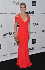 Kate Hudson was smoking at the amfAR Gala in this deep-plunging gown with cutout shoulders.
