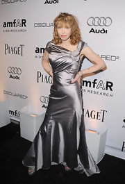 Courtney donned a silver floor length evening dress with a draped shoulder detail and full godets.