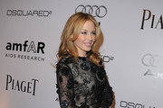 Singer Kylie Minogue arrives at the amfAR Inspiration Gala celebrating men's style with Piaget and DSquared 2 at Chateau Marmont on October 27, 2010 in Los Angeles, California.