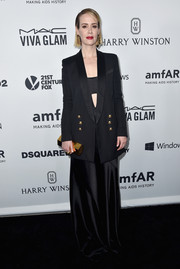 Sarah Paulson rocked an androgynous-meets-goth vibe in a Pallas tux jacket layered over an Osman cutout gown at the amfAR Inspiration Gala.