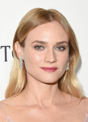 Diane Kruger glammed up her look with a pair of diamond chandelier earrings by Harry Winston.
