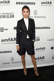 Zendaya Coleman styled her suit with a pair of bejeweled black sandals.
