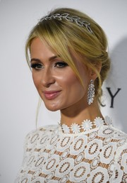 Paris Hilton accessorized with a pair of diamond chandelier earrings for more sparkle.