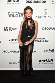 Alessandra Ambrosio complemented her dress with a black Jimmy Choo Ciggy clutch.
