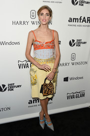 Chiara Ferragni did some chic color blocking, pairing her two-tone top with a beaded yellow skirt, also by Miu Miu.