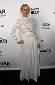 Paris Hilton kept it classy in a long-sleeve lace-bodice gown by Self-Portrait at the amfAR Inspiration Gala Los Angeles.