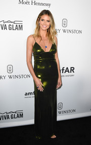 Heidi Klum amped up the allure with this low-cut metallic-green slip dress by Wolk Morais at the amfAR Inspiration Gala Los Angeles.