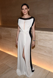 Rose McGowan looked effortlessly elegant at the amfAR Inspiration Los Angeles dinner in a black-and-white gown with keyhole detailing and a thigh-high slit.