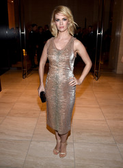 January Jones dazzled in a sequined nude dress by Tom Ford at the amfAR Inspiration Los Angeles dinner.