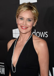 A long diamond tennis necklace added major glamour to Sharon Stone's sexy outfit at the amfAR Inspiration Los Angeles dinner.