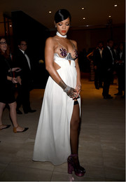 Rihanna finished off her showy ensemble with metallic purple platform sandals.