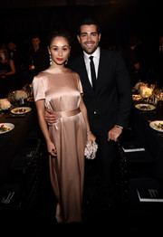 Cara Santana kept it modest yet elegant in a mauve satin evening dress during the amfAR Inspiration Los Angeles dinner.