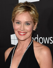 Sharon Stone sported a messy-chic 'do at the 2014 amfAR Inspiration Gala.