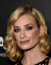 Beth Behrs looked like a doll with her perfectly sculpted waves at the amfAR Inspiration LA Gala.