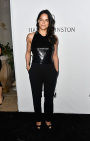 Michelle Rodriguez went for a minimalist look with this dual-textured black jumpsuit by Mugler at the amfAR Gala in Los Angeles.
