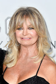 Goldie Hawn sported her signature eye-grazing bangs and flippy waves at the amfAR Gala in Los Angeles.