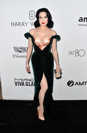 Dita Von Teese paired her dress with nude T-strap platform pumps by Christian Louboutin.