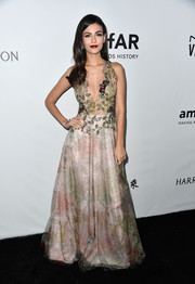 Victoria Justice looked like the goddess of spring in this PatBo foliage-print gown with an embellished illusion bodice at the amfAR Gala in Los Angeles.