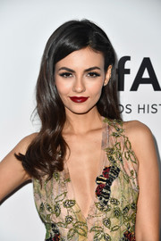 Victoria Justice sealed off her look with a bold red lip.