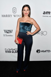 Sophia Bush kept it sleek and stylish in a strapless teal jumpsuit by Galvan, which she punctuated with red accessories, at the amfAR Gala in Los Angeles.