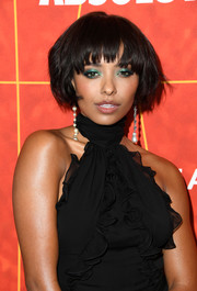 Kat Graham injected a pop of color with a swipe of emerald eyeshadow.