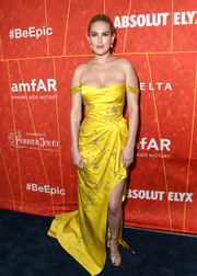 Rumer Willis paired her gorgeous dress with gold ankle-strap sandals by Christian Louboutin.