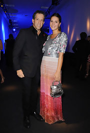 Margherita Missoni completed her shimmery ensemble with a metallic silver purse at the 2011 amfAR Milano event.