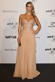 Bar Refaeli was stunning at the amfAR event in Milan in a beige gown with a sequined cutout bodice and a pleated skirt.