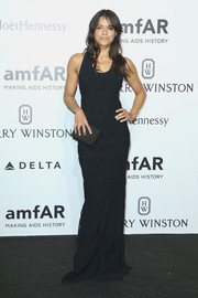Michelle Rodriguez's black evening dress at the amfAR Milano 2015 did an excellent job of showing off her gorgeous figure.