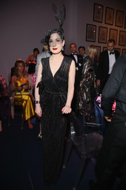 Dita Von Teese was pure sophistication in a beaded black wrap dress by Elisabetta Franchi at the amfAR Milano 2016.