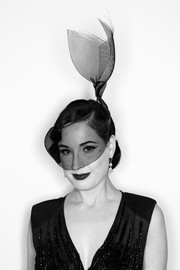 Dita Von Teese looked dramatic wearing this decorative mesh hat from Hood London at the amfAR Milano 2016.