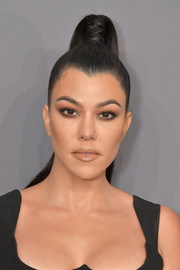 Kourtney Kardashian looked edgy-chic with her tight, high ponytail at the 2019 amfAR New York Gala.
