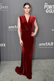 Hilary Rhoda was the picture of elegance in a red velvet wrap gown by Monique Lhuillier at the 2019 amfAR New York Gala.