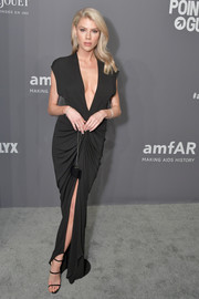 Charlotte McKinney finished off her look with black triple-strap sandals.