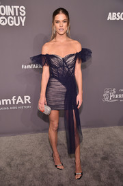 Nina Agdal paired her dress with bedazzled black sandals by Giuseppe Zanotti.