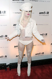 Lady Gaga topped off her winter white look with sky-high lace up boots.
