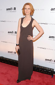 Cynthia looks chic and easy on the red carpet in a timeless brown maxi dress with a subtly sexy neckline.