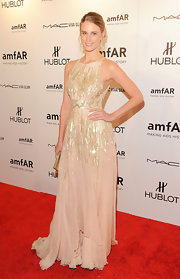 Julie Henderson donned a glittering cream gown to the amfAR Fashion Week gala.