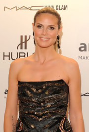 Heidi Klum wore her hair in a sleek ponytail while attending the amfAR Gala.
