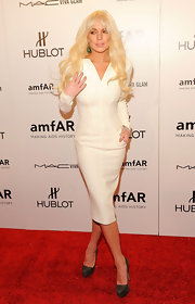 Lindsay Lohan wore a white sheath dress with pockets to the amfAR New York Gala to kick off Fashion Week.