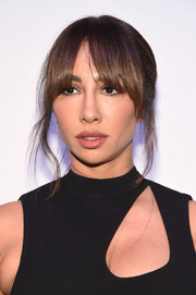 Jackie Cruz opted for a loose updo with eye-grazing bangs when she attended the amfAR generationCURE Solstice 2017.