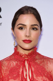 Olivia Culpo pulled her tresses back into a center-parted ponytail for the amfAR generationCURE Solstice 2017.