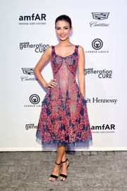 Victoria Justice cut a girly figure in an embroidered navy and coral dress by Zac Posen at the amfAR generationCURE Solstice 2017.