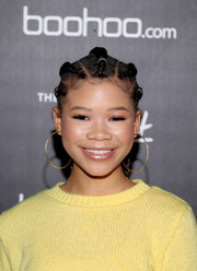 Storm Reid paired her cool 'do with oversized gold hoops.