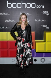 Greer Grammer arrived for the Boohoo Block Party wearing a black leather biker jacket.